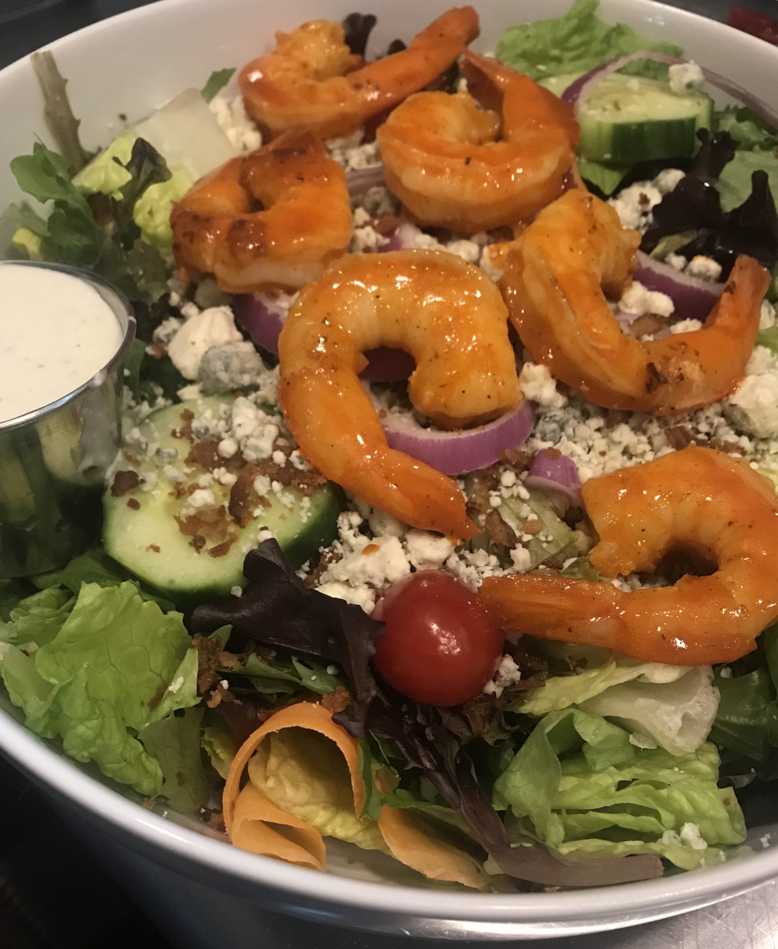 Salad with shrimp in a bowl.