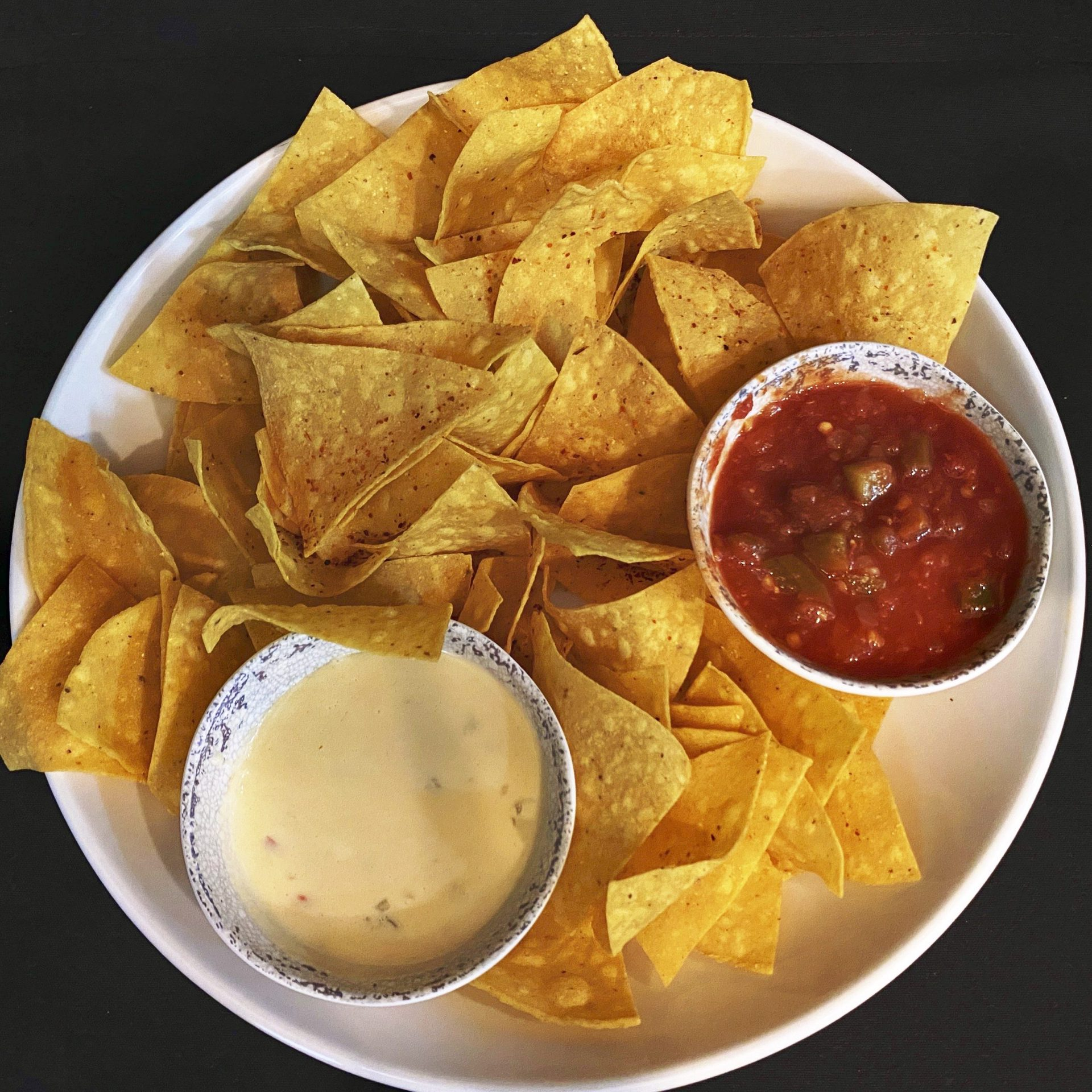 Chips and dip on a plate.