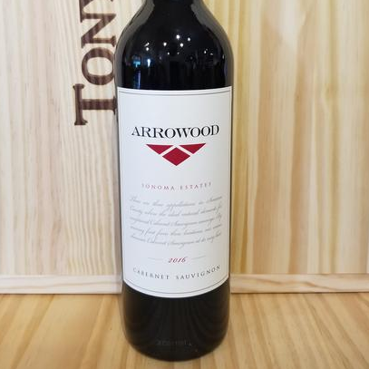 Bottle of wine on table.