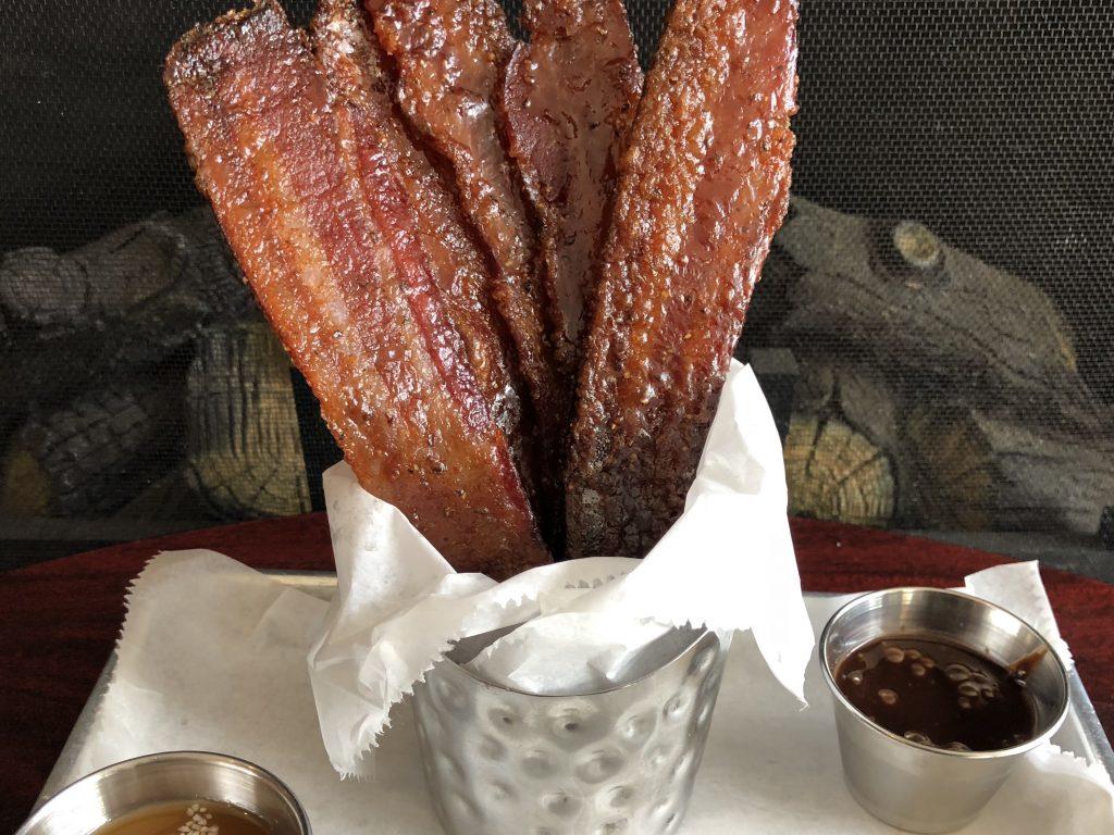 Strips of bacon in a basket.