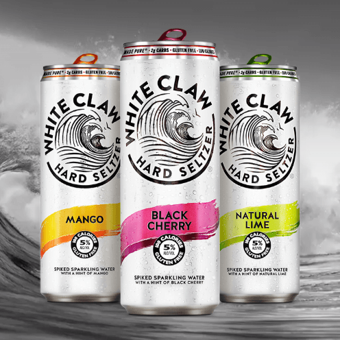 Cans of drinks against backdrop.